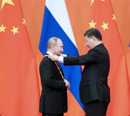 Xi awards Putin China's first friendship medal